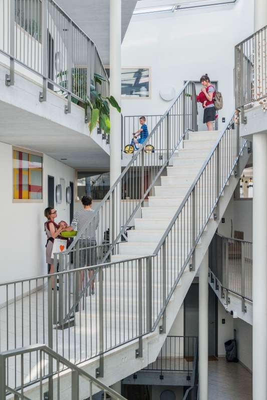 The social mix across Mehr Als Wohnen is immediately evident, and builds a genuine, and diverse, community of residents. Here, residents are shown gathering in the stairwell of Duplex Architekten's House M.