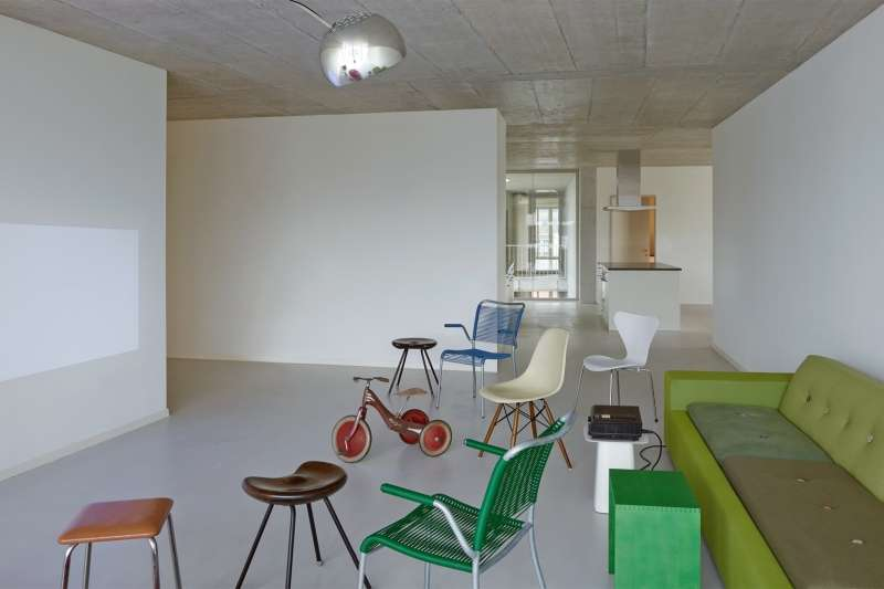 The common room of Duplex Architekten's House A acts as a share space for a cluster of residents.